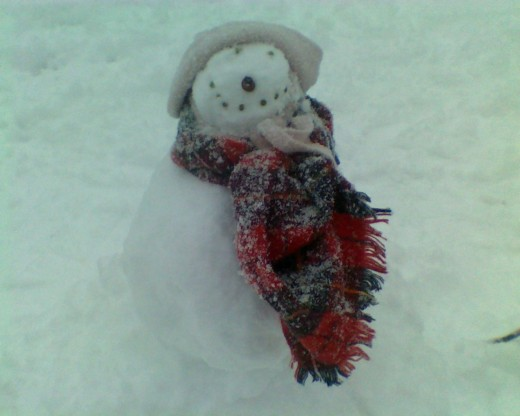 """Sally the little snowgirl,"" built on a blustery day last winter"