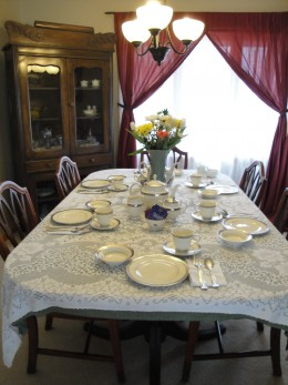 One of two tables set with fine china.