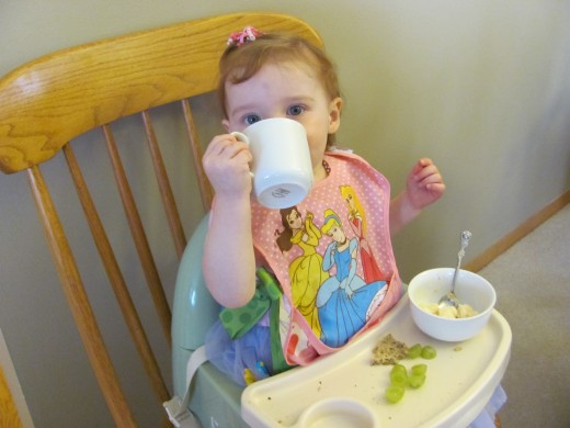 "Drinking from her Beatrix Potter ""china"" Grandma brought for her."
