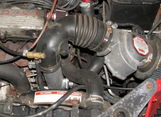 Example of also using a larger J-pipe (behind radiator)