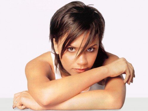 Victoria Beckham wearing an early hair style