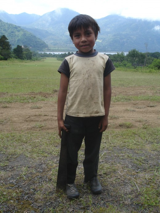 Notice this little one holding a machete.  Children are taught to use them as early as 4 years old.