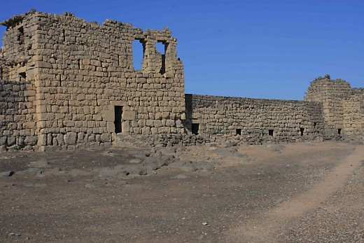 The main courtyard and the outer wall of the Blue Fort at Qasr al-Azraq in the Jordanian desert