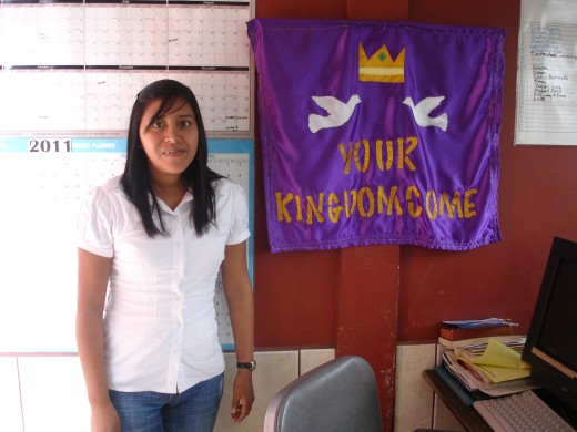 """Brenda the office manager standing by the sign that says """"Your Kingdom Come""""  It was what I prayed before I left for Guatemala"""