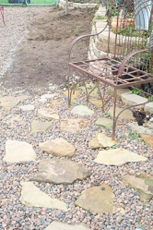 A small stone patio was added to the shade garden, where the gazeo used to be