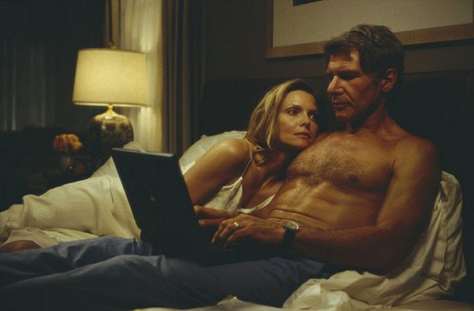 Michelle Pfeiffer and Harrison Ford in bed together at the beginning of the movie.