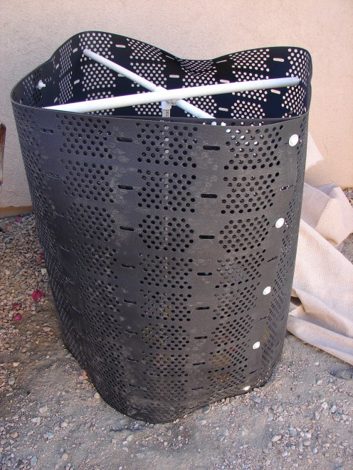 This aerator is a simple affair that keeps the critters out and the heat and air in. My husband put pvc pipe in a criss-cross so it would keep its shape. We cover it with netting and a board on top.