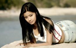 Sarah Gurung in a white top at beach side