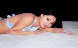 Sarah Gurung looking beautiful on bed