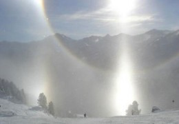 This unusual photo resulted in sundogs that are very pronounced as it was taken within a light ice fog at high altitude.