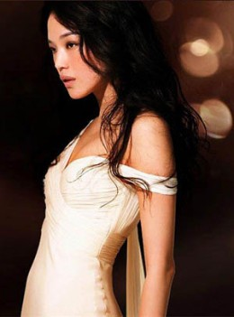 Shu Qi in a long white dress