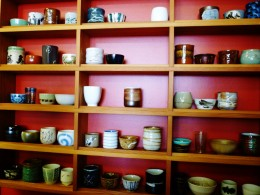 Shelving with choices of pretty teacups where we each chose one from which to drink our tea.