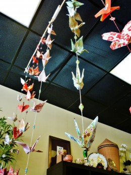 Strings of origami hang from the ceiling.