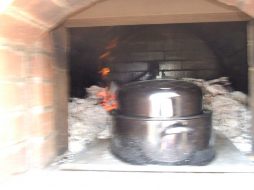 Placing Roaster in the Brick Oven