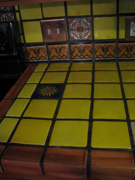 Yellow talavera tile kitchen countertop.