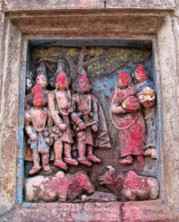 Another  of the terracotta figures on the facade of the main temple  (Krisna with associates)