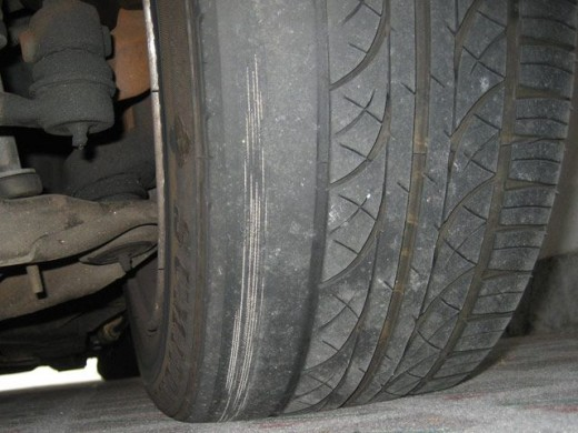 This tire shows extreme inner wear, indicating incorrect camber settings.