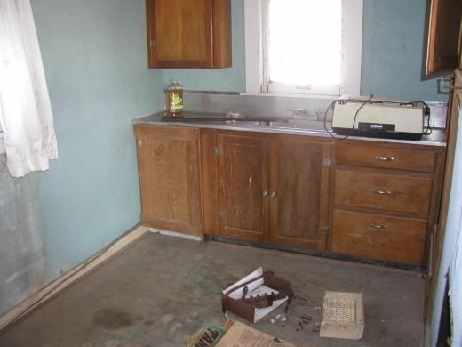 Cabin kitchen before