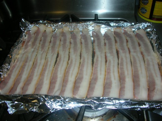 Raw bacon on foil lined tray