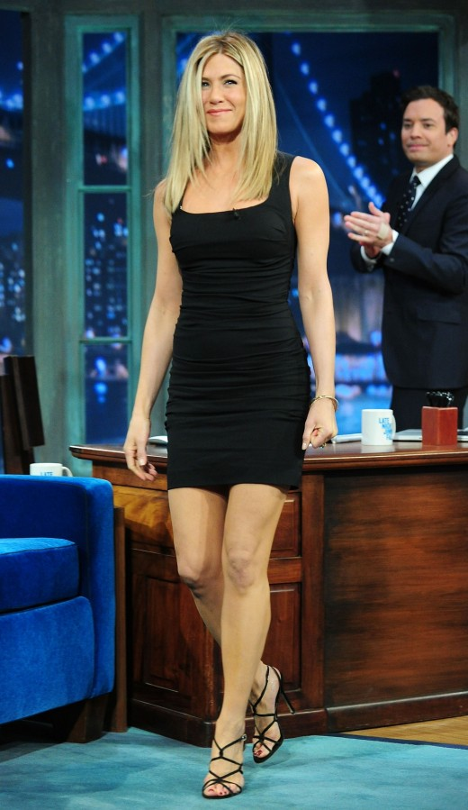 Jennifer Aniston in a little black dress and high heels on Jimmy Fallon.