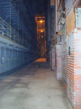 View from first floor of jail area. The cells are to the left, the brick fireplaces are on the right.