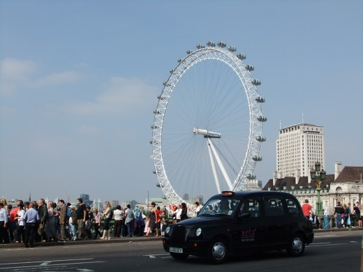 The London Eye taken from near Big Ben, with traditional London Cab in the forefront