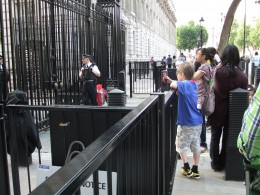 My son taking photos of Downing Street through the gates