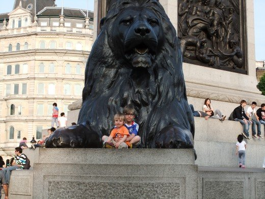 Trafalgar Square, on the lion (do not allow your young child up here unsupervised as it is very high)