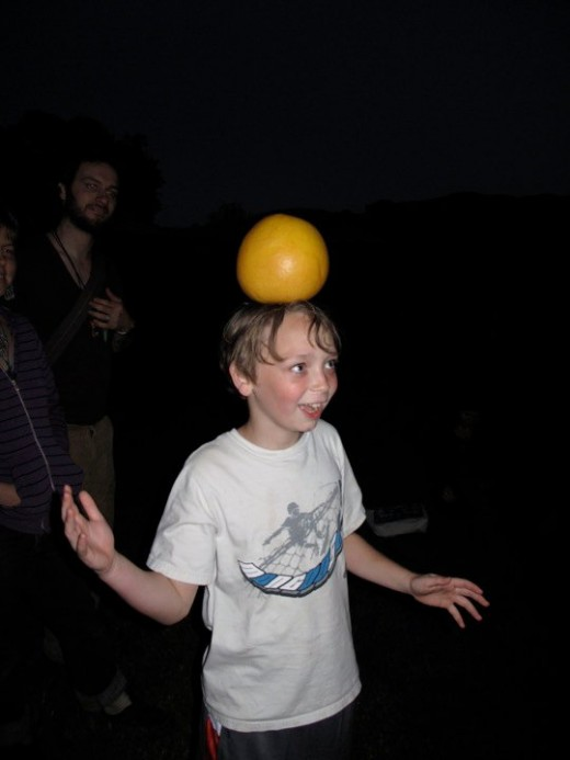 EDEN and her son MERLIN balancing GRAPEFRUITS on their HEADS