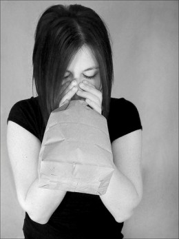 Breathing in a paper bag should cover your nose and mouth. This is because it is better to breath in through the nose and out the mouth.