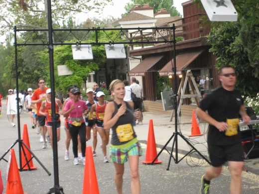 Runners reach Los Olivos, the halfway point of the Santa Barbara Wine Country Half Marathon