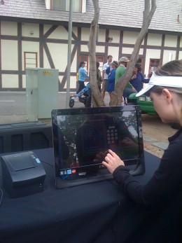 A runner gets her digital race results, which can be printed minutes after finishing