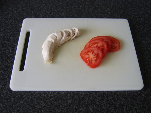 Chicken breast and tomato are sliced
