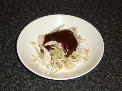 Chicken is mixed with the beansprouts and the hoisin sauce