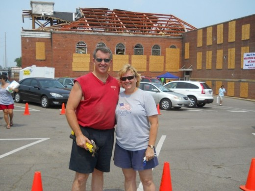 Bruce and Jennifer Mills stand in the parking lot of the Alberta Baptist Church.