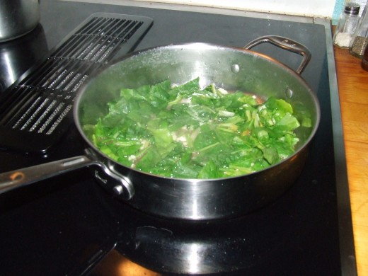 Swiss Chard & Garlic reducing in saute' pan.