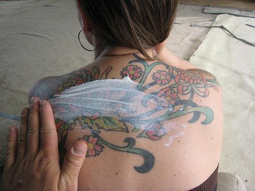 Applying sunscreen.  Sunscreening Alison by JasonUnbound, on Flickr