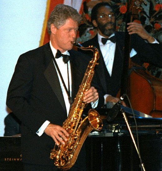 Former US President Bill Clinton playing the saxophone.