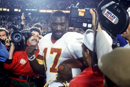 Doug Williams Earns  MVP honors in in Super Bowl XXII, becoming the first black quarterback to lead his team there, win  and become MVP   I'm about  watch the Super Bowl and we got a black quarterback... so step back- Flava Flav