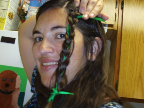Braiding a ribbon into your hair can be a festive or an everyday look.