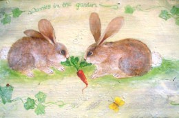 two bunnies on a bench