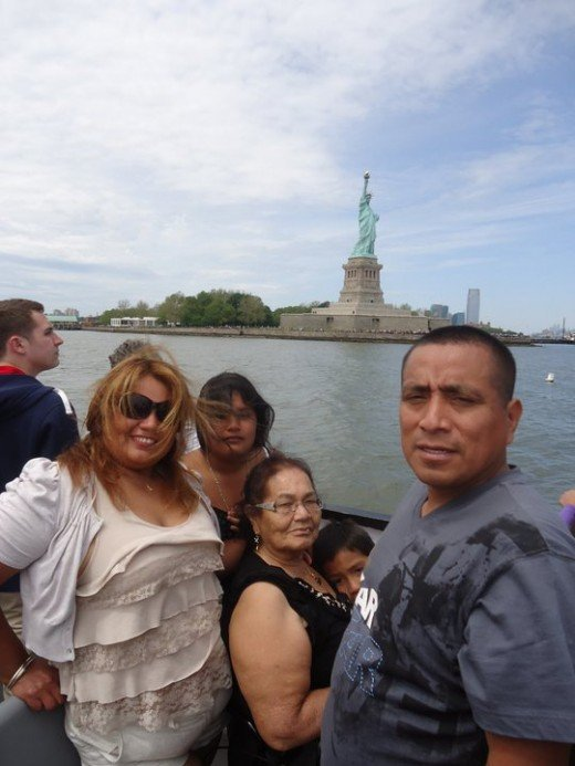 The Camarena family sightseeing in the ferry. In this picture is Carmen(L), her daughter in the background, Carmen's mother with their son Emmanuel and Carlos, her husband.(R)