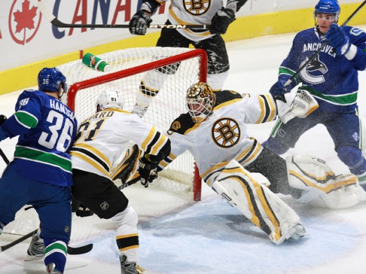 This dramatic photo of game three of the Canucks vs the Bruins demonstrates the intensity of a high speed hockey game and why the athletes have to be in top performance.