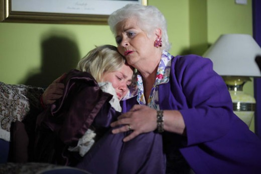 Pat comforts Janine