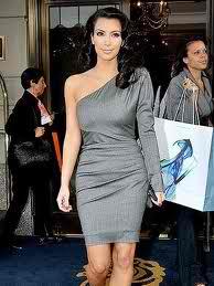 Kim Kardashian loves the one arm trend.
