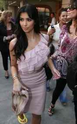 Here Kim rocks a one armed ruffled dress. Yes guys ruffles are back.