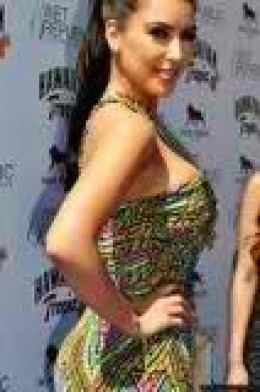 Here's Kim in a beautiful green one armed print dress.