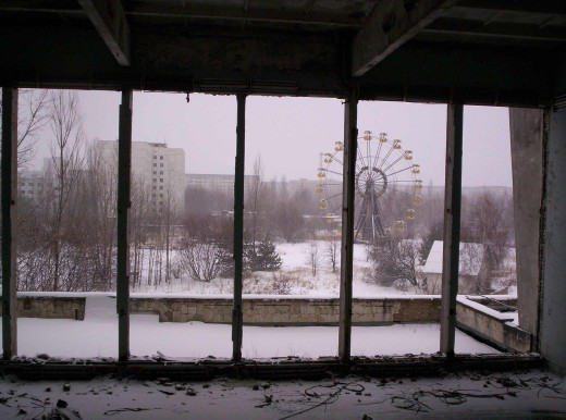 Pripyat's ferris wheel as seen from a nearby balcony, untouched since '86.