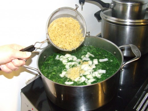 Orzo, rinsed and added to cooking pot.