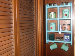 I bought this shelf in a thrift shop to keep tea ever ready.  No searching for tea in the kitchen cabinets for us.